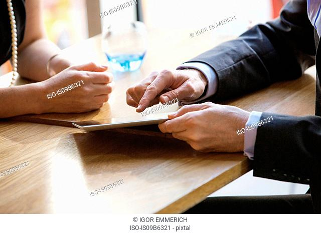 Businessman and businesswoman working