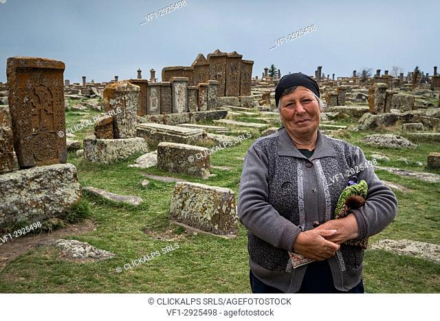 Armenian woman in the historical cemetery of Noratus near Lake Sevan, Armenia, Caucaus, Eurasia