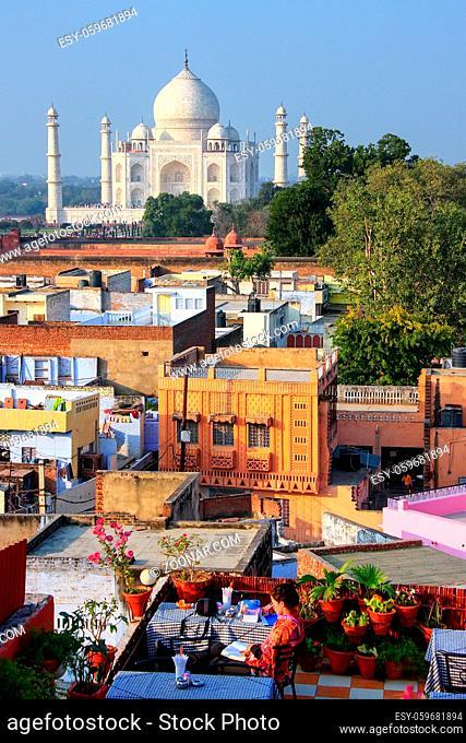 View of Taj Mahal from the rooftop restaurant in Taj Ganj neighborhood in Agra, India. Taj Mahal was build in 1632 by Emperor Shah Jahan as a memorial for his...
