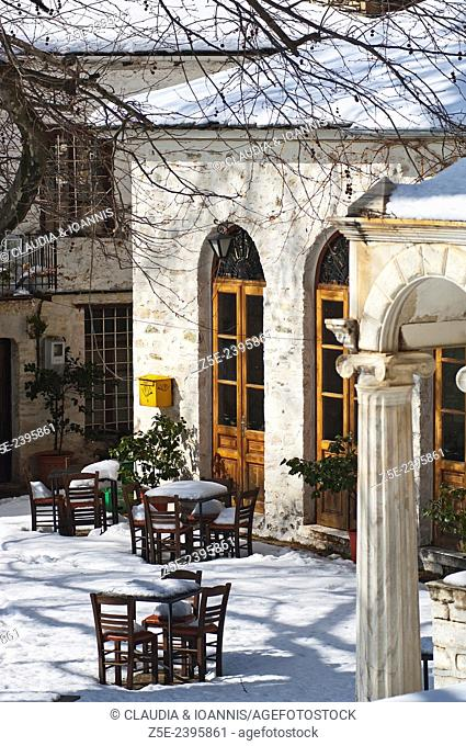 Snowy village scene with letterbox on Pelion Peninsula, Thessaly, Greece