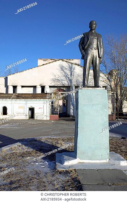 A Small Statue Of Lenin Stands At The Entrance To An Abandoned Clothing Factory In The Town Of Kyakhta. The Town Is A Heavily Militarised Post On The...