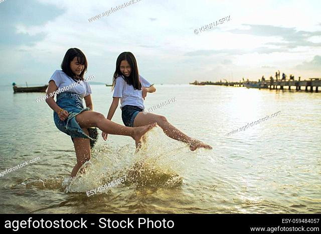 asian teenager relaxing on vacation sea beach