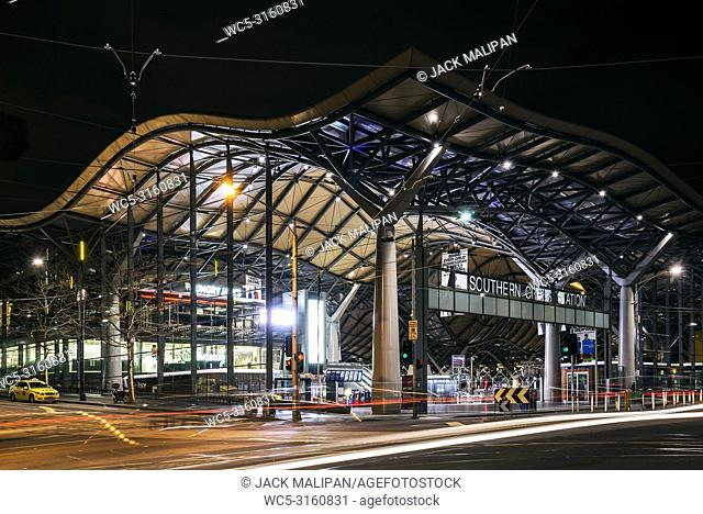 street scene with exterior of southern cross railway station in central melbourne australia at night