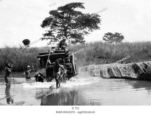 a difficult crossing over the river chikumi, rhodesia, africa 1930-40