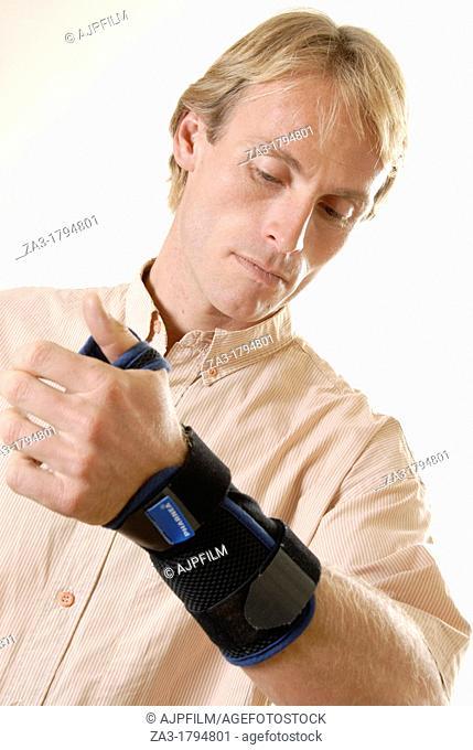 Man with a wrist brace