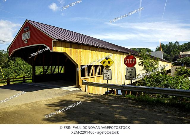 The Bath Covered Bridge in Bath, New Hampshire during the summer months. This historic covered bridge crosses over the Ammonoosuc River