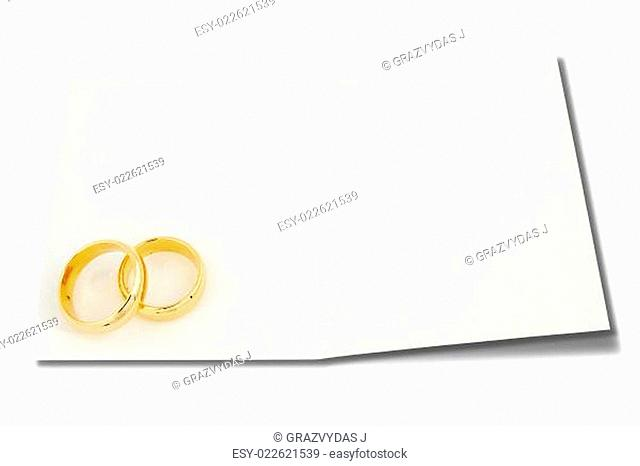 Wedding rings on the card for text