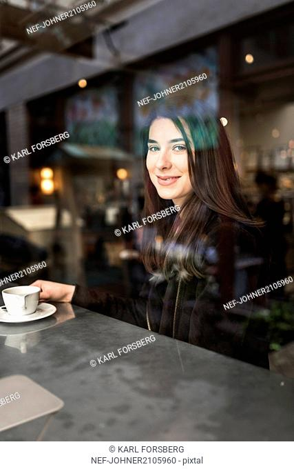 Smiling woman in cafe