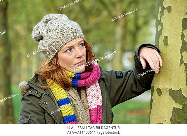 Pensive woman in autumn