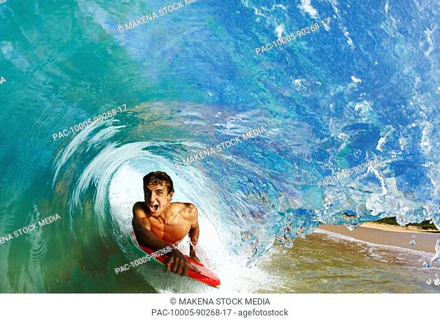 Hawaii, Maui, Makena - Big Beach, Boogie boarder riding barrel of beautiful wave