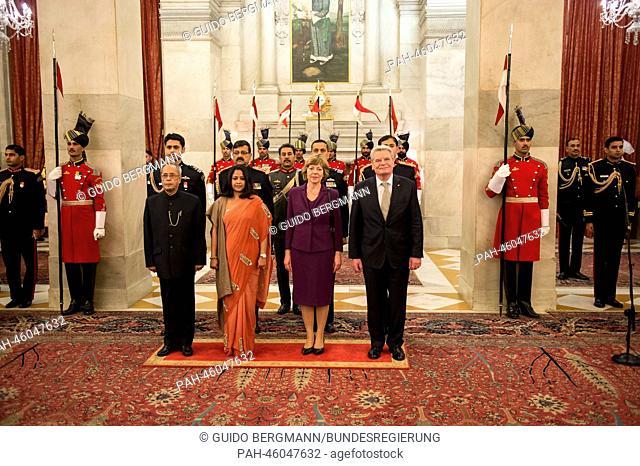 German President Joachim Gauck (R), his partner Daniela Schadt (C), President of India Pranab Mukherjee (L) and his daughter Sharmistha pose before the State...