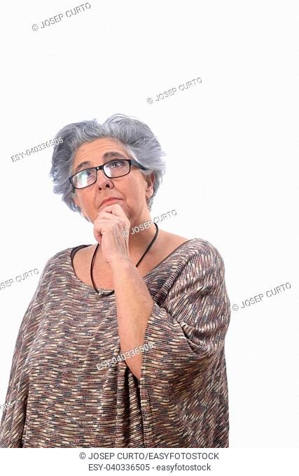 thoughtful senior woman on white background