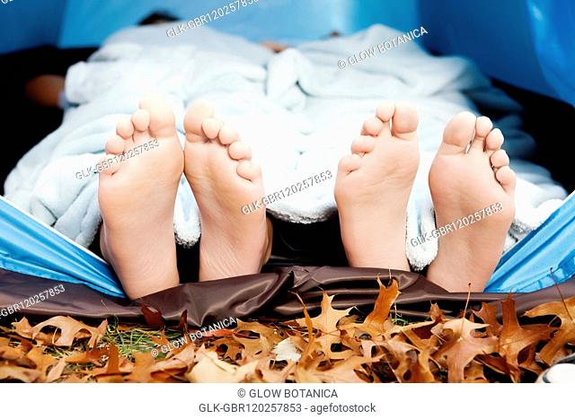 Feet of two people under a tent