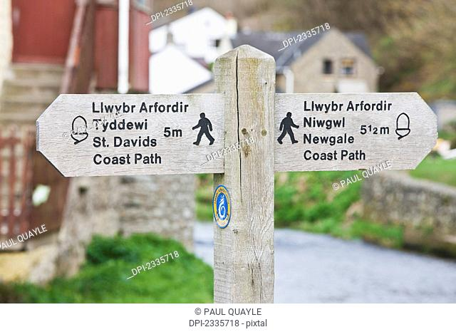 A wooden sign and post for walking paths; Wales
