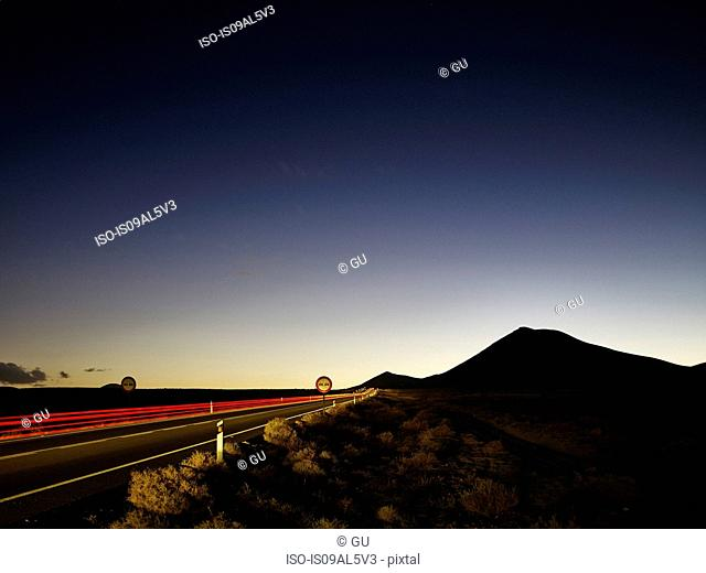 Highway taillight trails at dawn, Lanzarote, Spain