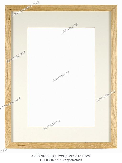 Empty picture frame of light oak wood with a mount