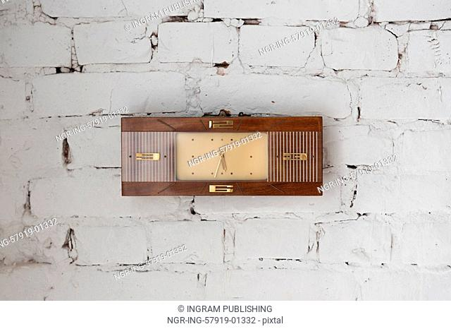 Vintage watches on white brick wall