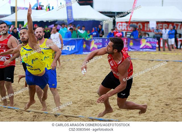LAREDO, SPAIN - JULY 30: Unidentified player launches to goal in the Spain handball Championship celebrated in the beach of Laredo in July 30, 2016 in Laredo
