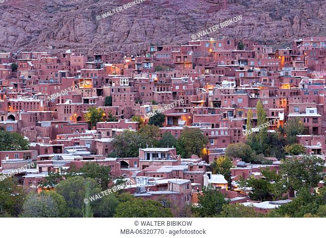 Iran, Central Iran, Abyaneh, elevated village view, dusk