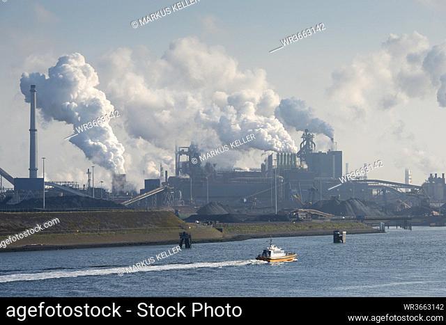 Netherlands, Amsterdam, View of Tata steel plant on North Sea coast