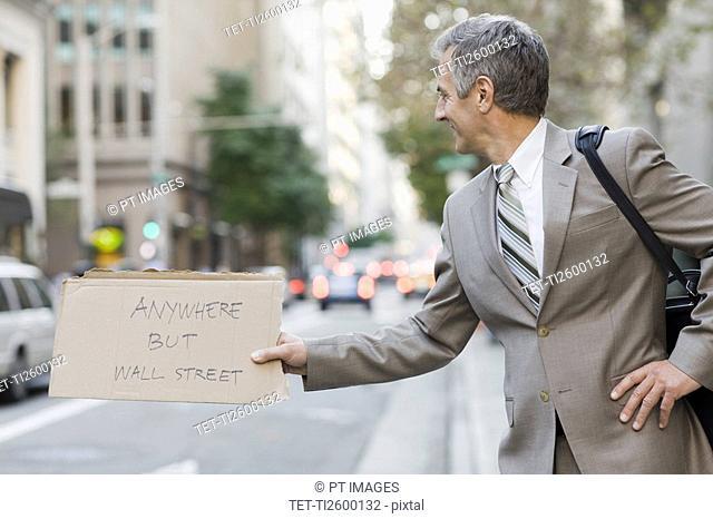 Businessman hitchhiking