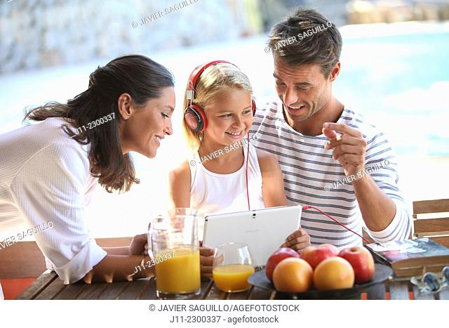 Family, girl with digital tablet and headphones