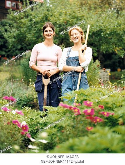 Women standing in the garden and work