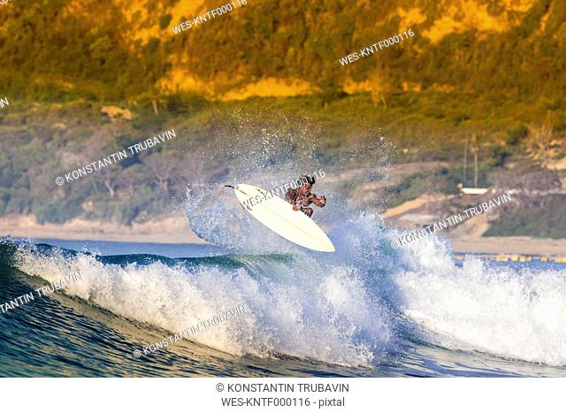 Indonesia, Lombok, surfing man