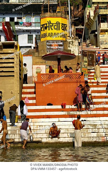 People bathing in holy Ganga river at Rabharavi ghat ; Varanasi ; Uttar Pradesh ; India