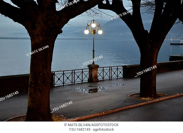 Street lamp on the lake front at night