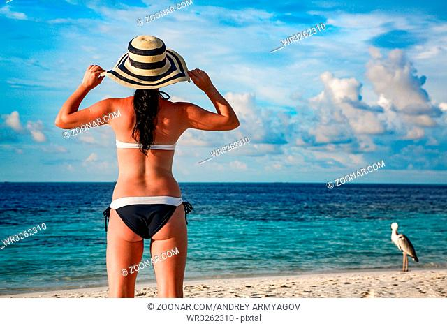 Beach vacation.Woman and tropical beach in the Maldives