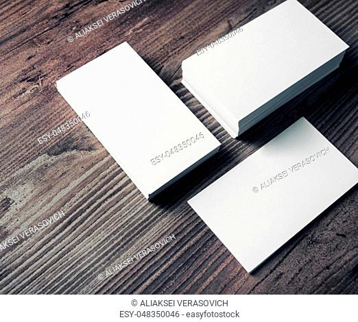 Photo of blank business cards on wooden background. Template for ID