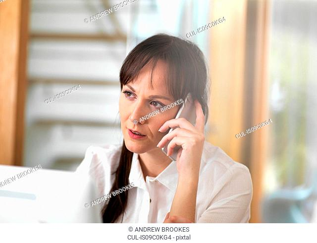 Woman talking through a business issue over the phone