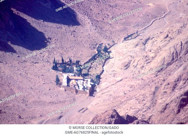 Aerial view from an airplane flying over a walled citadel or fortress in a valley in the Sinai Desert, Israel, November, 1967