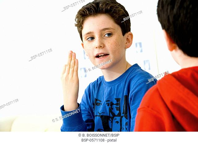 CUED SPEECH Models. Do not use for HIV. Young boy using cued speech to discuss with his brother affected by deafness. Cued speech enables deaf persons to...