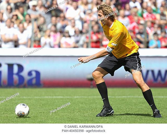 Professional basketball player Dirk Nowitzk plays the ball during the charity soccer match between 'Manuel Neuer & Friends' and 'Nowitzki Allstars' in Wuerzburg