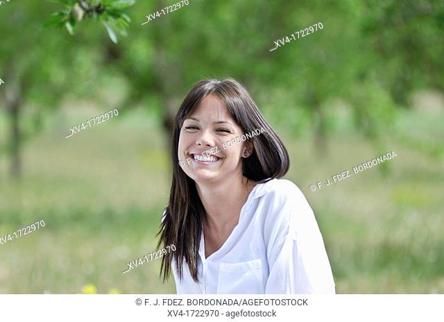 Brunette breathing fresh air in the ruralscape