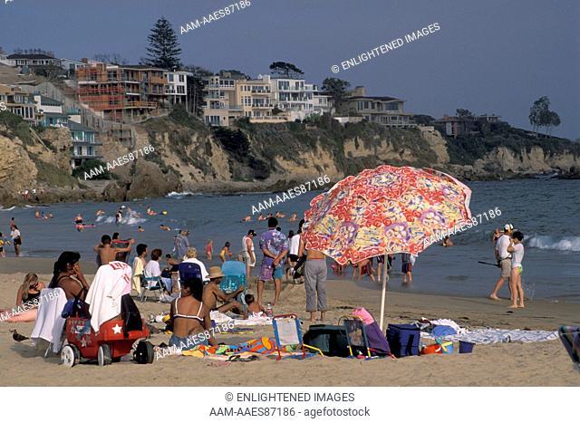 Crowded sand beach and sunbathers and umbrella, Corona del Mar, Newport Beach, California