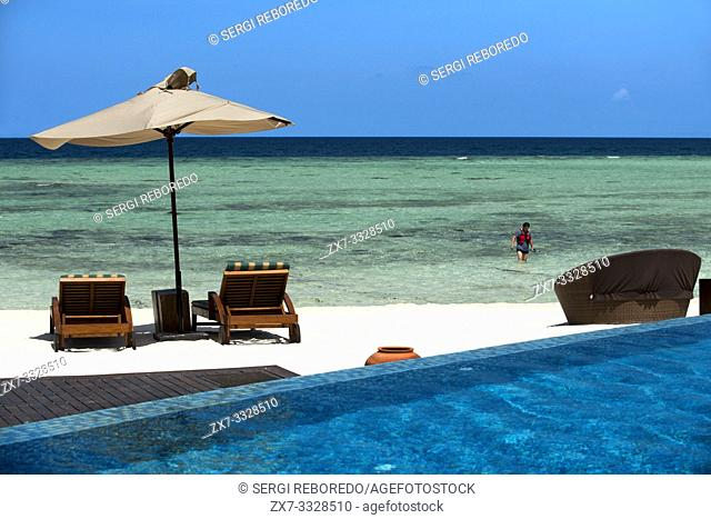 Swimming pool and restaurant in The Residence Hotel and Resort, Gaafu Alifu Atoll. Maldives Islands