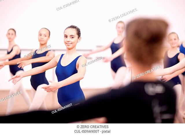 Teacher in front of teenage ballerinas