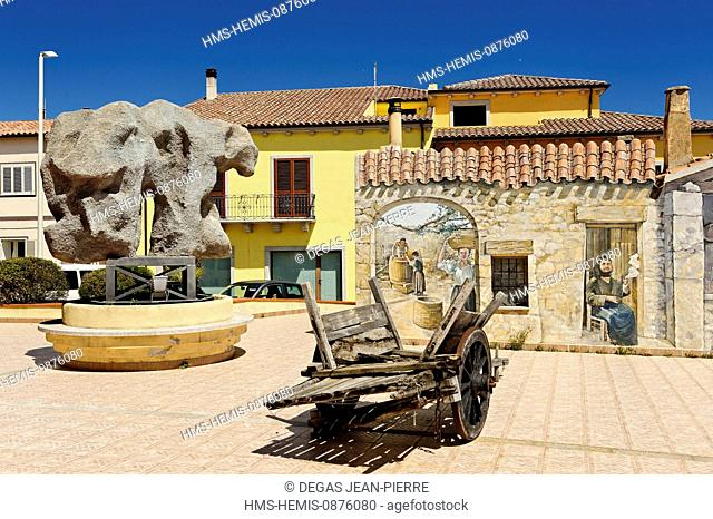Italy, Sardinia, Olbia Tempio Province, the Emerald Coast (Costa Smeralda), Palau, Via Nazionale, Ethnographic Museum, wooden wagon in front of a mural painted...