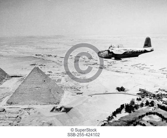 Egypt, Giza, Aeroplane flying over Giza Pyramids