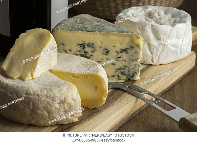 French cheese platter with variety of different cheeses for dessert