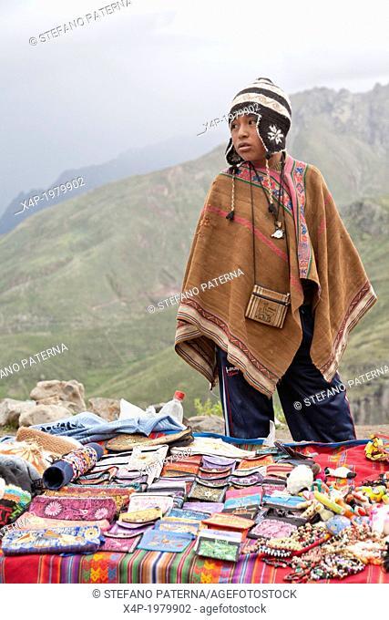 Young indigenous boy selling souvenirs, Colca Canyon, Peru