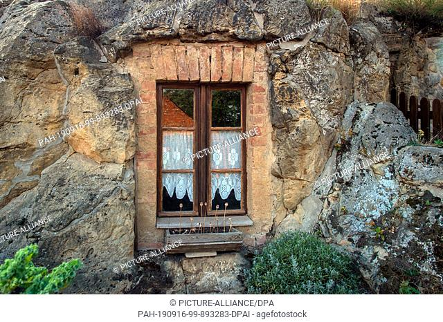 11 September 2019, Saxony-Anhalt, Langenstein: The window of a cave dwelling on the Schäferberg. There were 10 rock dwellings on the Schäferberg