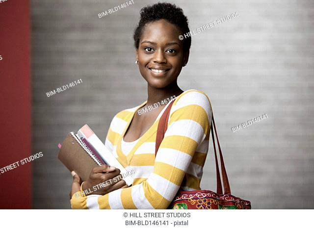 African American woman holding textbooks