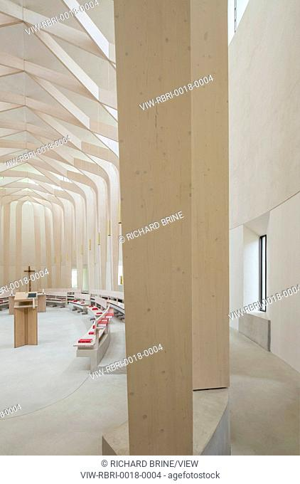 Ripon Chapel, Cuddesdon, United Kingdom. Architect: Niall McLaughlin Architects, 2014. View from ambulatory looking into the main chapel towards the lectern