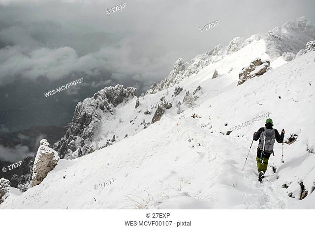 Mountaineer hiking, Italian Alps, Lecco, Lombardy, Italy
