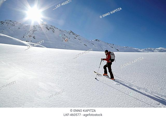 Woman ski touring in Villgraten Valley, Hohe Tauern, East Tyrol, Austria
