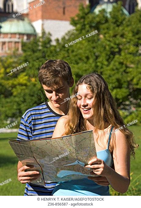 Poland Krakow, Couple with city map by Wawel Castle
